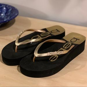 Bebe Flip Flop Thongs with Gold Accents